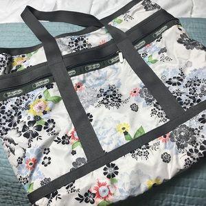 LeSportsac tote bag floral print with grey trim.